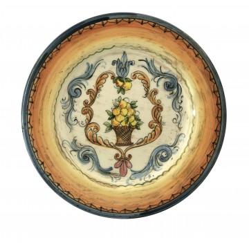 Piatto grande in ceramica cotta e decorata a mano