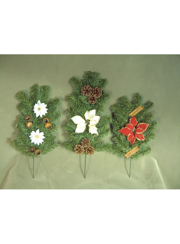 Three pine branches set with pine cones, stars and spices