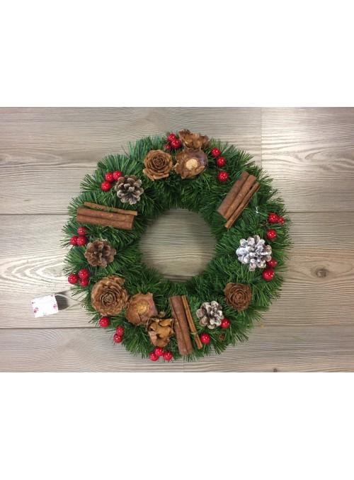 Green garland with pine cones and berries