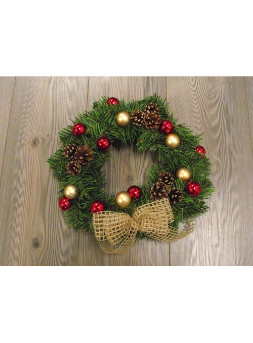 Green garland with bow, pine cones and balls