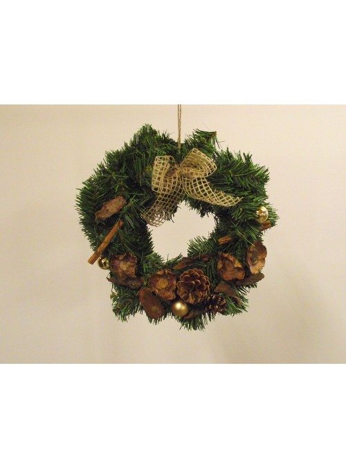 Green garland with bow, pine cones and spices