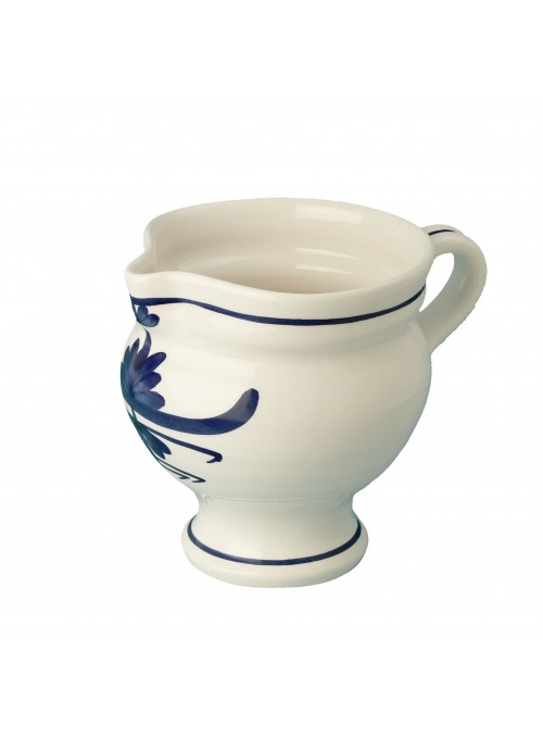 Pitcher in painted porcelain with blue decoration