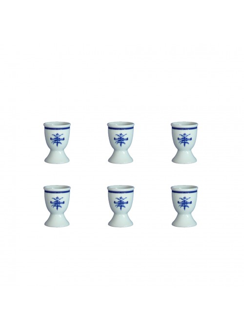 Six eggcups set in painted porcelain with blue decoration