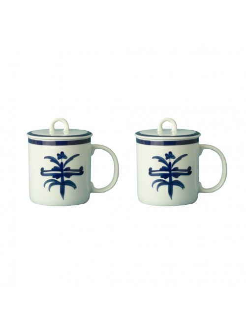 Two mugs in painted porcelain with blue decoration