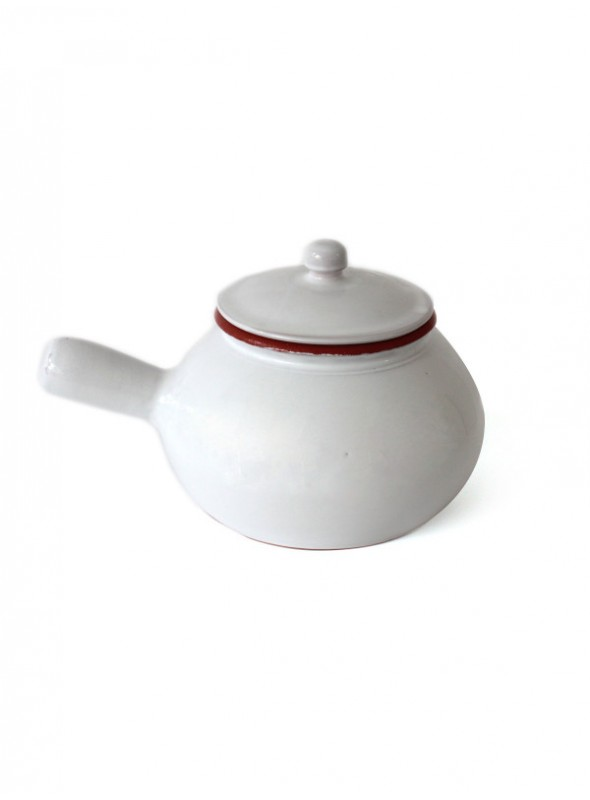 White fire clay pan for cooking potatoes