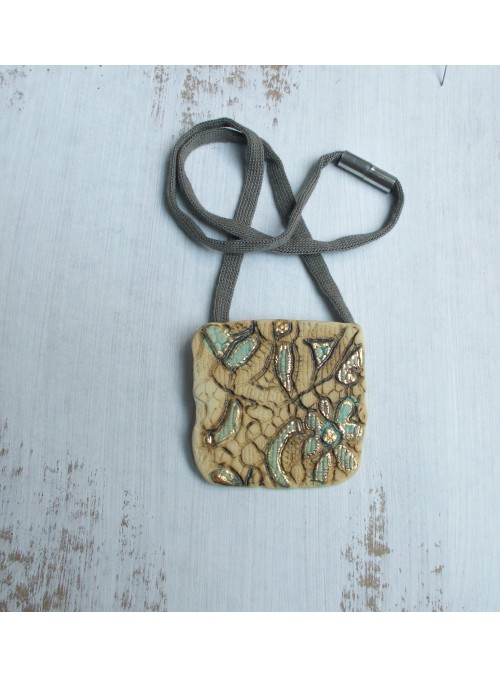 Necklace with embossed ceramic small plate