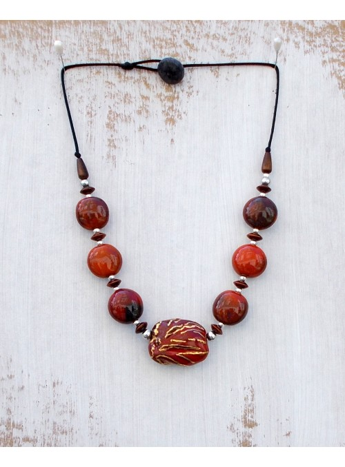 Necklace with red ceramic beads