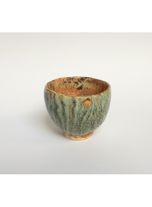 Rounded cup in neriage ceramic and gold
