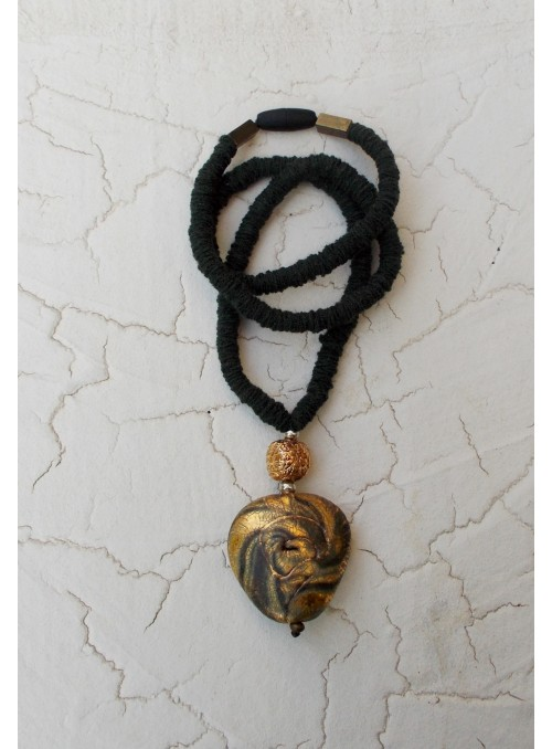 Necklace with drop shaped pendant and bead