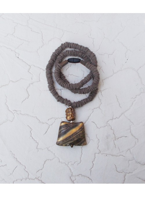 Necklace with geometric pendant in brown and gold