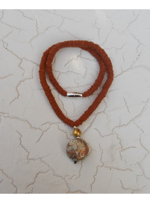 Necklace with rounded pendant and golden bead