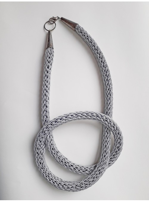 Tubolar necklace with knot crafted in silver metal wire